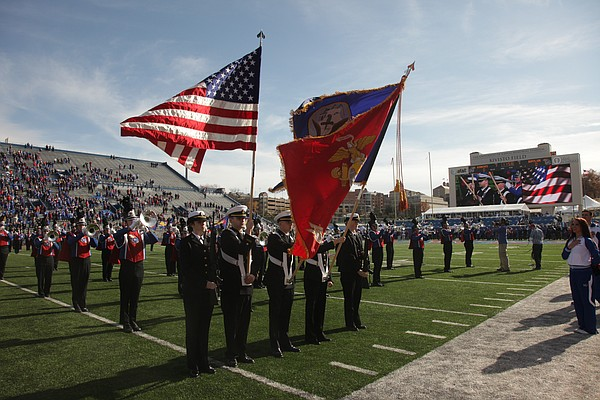 Members of the military present the colors to the crowd at Memorial Stadium on Saturday, Nov. 12, 2011 at Memorial Stadium.