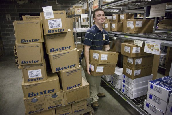 James Griffin sorts through supplies Friday, Nov. 11, 2011, in the materials management department at Lawrence Memorial Hospital, 325 Maine. Griffin is participating in Project Search, a new program offered in Lawrence, which provides education and job training for young adults, ages 18-21, who have intellectual and developmental disabilities.
