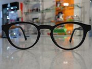 A pair of circle-frame glasses from Wink, 806 Mass.