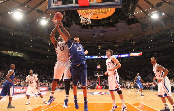 Kansas forward Thomas Robinson vies for a rebound with Kentucky forward Anthony Davis during the second half Tuesday, Nov. 15, 2011 at Madison Square Garden in New York.
