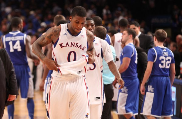 Kansas players Thomas Robinson (0) and Elijah Johnson make their way from the court following the Jayhawks' loss to Kentucky on Tuesday, Nov. 15, 2011 at Madison Square Garden in New York.