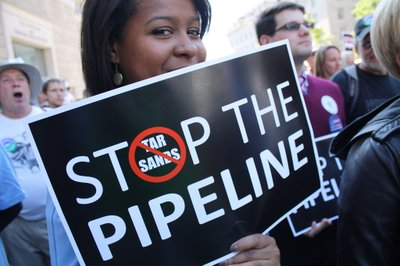 Keystone XL Oil Pipeline Hearing Rally at the Ronald Reagan Building & International Trade Center on 14th Street between Pennsylvania Avenue and Constitution Avenue in NW Washington DC on Friday afternoon, 7 October 201
