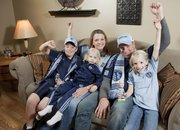 The Urban family are big fans of Sporting Kansas City, a Major League Soccer team. Julie and her husband Brandon cheer at home with their children, from left, Ben 10; Molly, 2; and Grace, 8.