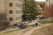 Kansas University students wait outside Malott Hall around 10:30 a.m. Wednesday, Nov. 16, 2011, after the building was evacuated following reports of a chemical spill. No spill was found, and students were readmitted shortly after 11 a.m.