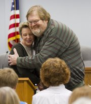 Jane Rock got a hug from John Drees after she presented him as a friend for his role as Lawrence Memorial Hospital's community education specialist. A Friends of Education reception was help Wednesday at the Lawrence school district offices as part of an American Education Week celebration of school volunteerism.