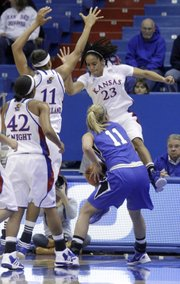 From left, KU's Natalie Knight, Aishah Sutherland and Keena Mays (23) defend against the BlueJays' McKenzie Fujan in the Jayhawks' non-conference game against Creighton on Nov. 16, 2011.