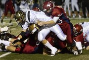 Eudora defensive back Chris Pyle pulls down Paola running back Tyler Henness for a loss during the 2011 Kansas 4A sub-state championship Friday, Nov. 18, 2011 in Eudora.