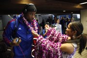 Kansas forward Thomas Robinson receives a lei as a welcoming gesture upon the Jayhawks' arrival at the Kahului Airport on Friday, Nov. 18, 2011 in Maui.