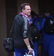 Kansas head coach Bill Self smiles as the team heads for their bus after arriving at the Kahului Airport on Friday, Nov. 18, 2011 in Maui.