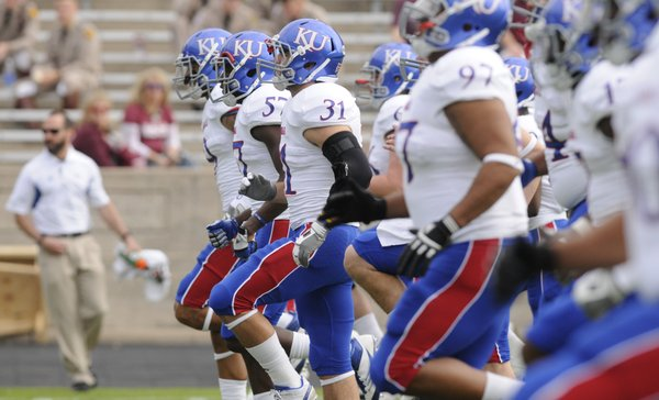 The Kansas football team warms up before taking on Texas A&M on Saturday, Nov. 19, 2011 at Kyle Field in College Station, Texas