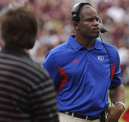 Kansas head coach Turner Gill walks the sidelines during the first half Saturday, Nov. 19, 2011 at Kyle Stadium in College Station, Texas.