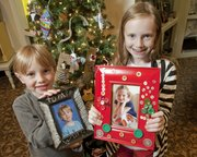 Will Richards, 6, and his sister Catharine, 9, show off their hand-decorated picture frames they made for their grandparents.