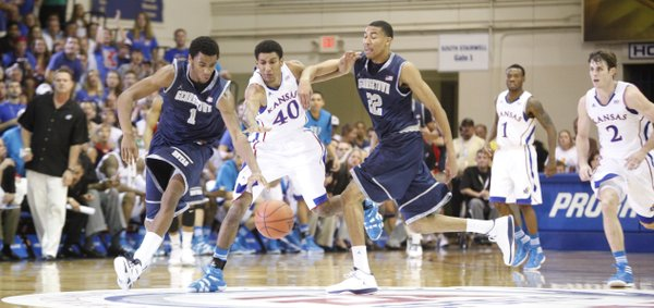 Kansas forward Kevin Young splits Georgetown defenders Hollis Thompson (1) and Otto Porter (22) after a steal during the first half Monday, Nov. 21, 2011 at the Lahaina Civic Center.