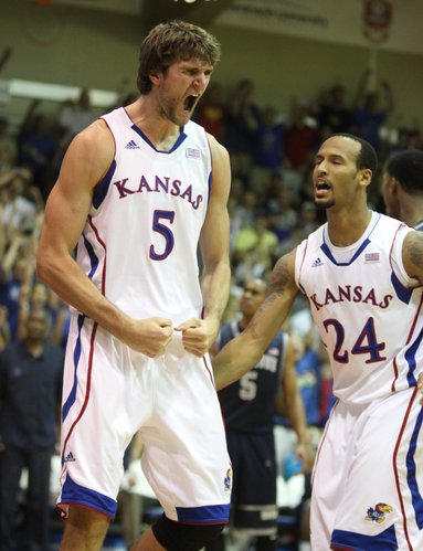 Kansas center Jeff Withey celebrates a dunk with teammate Travis Releford after being fouled by Georgetown during the first half on Monday, Nov. 21, 2011 at the Lahaina Civic Center.