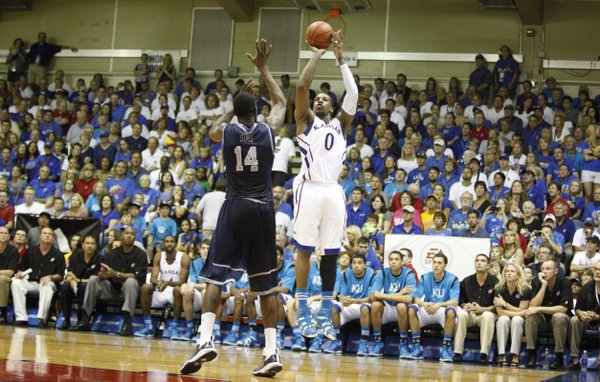 Kansas forward Thomas Robinson pulls up for a jumper over Georgetown forward Henry Sims during the second half on Monday, Nov. 21, 2011 at the Lahaina Civic Center.