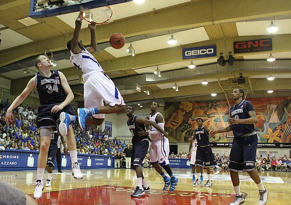 Kansas forward Justin Wesley delivers on an alley-oop dunk against Georgetown during the first half on Monday, Nov. 21, 2011 at the Lahaina Civic Center.