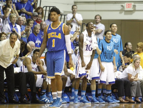 Kansas guard Tyshawn Taylor (10) celebrates on the bench next to teammates Niko Roberts and Merv Lindsay as the Jayhawks go on a run against UCLA during the first half Tuesday, Nov. 22, 2011 at the Lahaina Civic Center.