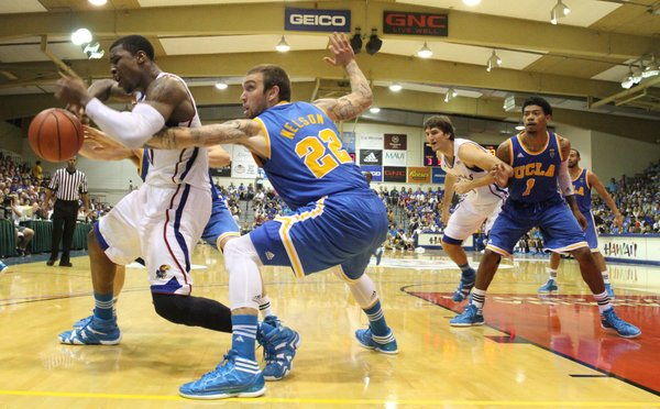 Kansas forward Thomas Robinson loses control of the ball after jump ball with UCLA forward Reeves Nelson during the second half Tuesday, Nov. 22, 2011 at the Lahaina Civic Center.