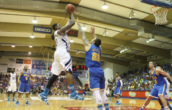 Kansas forward Thomas Robinson turns for a shot over UCLA forward Reeves Nelson during the second half Tuesday, Nov. 22, 2011 at the Lahaina Civic Center.