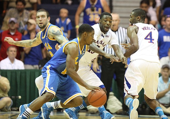 Kansas guard Elijah Johnson defends UCLA guard Lazeric Jones as he drives during the second half on Tuesday, Nov. 22, 2011 at the Lahaina Civic Center.