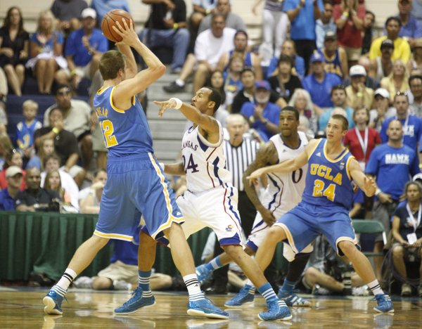 Kansas guard Travis Releford defends a pass from UCLA forward David Wear during the second half Tuesday, Nov. 22, 2011 at the Lahaina Civic Center.