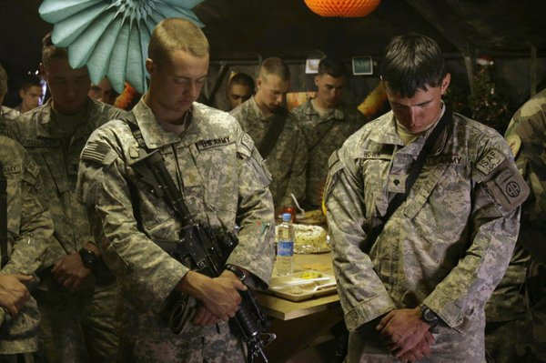 In this file photo taken Nov 22, 2007, United States soldiers offer prayers during a Thanksgiving Day celebration at a forward operating base Airborne in Wardak, Afghanistan. Counting your blessings this Thanksgiving isn't just a tradition. It's something that's good for you. Psychologists have studied the brain chemistry and positive effects of being grateful, something that works even in trying times like these and the ones that exited at the first Thanksgiving.