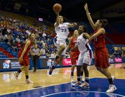 Kansas' Keena Mays (23) slices through the Lamar defense for an easy layup during Kansas' game against Lamar in the Basketball Travelers Classic Friday, Nov. 25, 2011 at Allen Fieldhouse. Kansas defeated Lamar 90-40 to improve its record to 4-0.