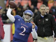 Kansas quarterback Jordan Webb warms up before the start of the Border Showdown on Saturday, Nov. 26, 2011 at Arrowhead Stadium.
