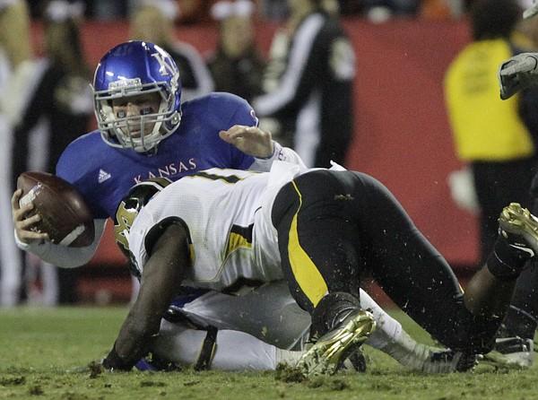 Missouri's Kenji Jackson sacks Kansas quarterback Jordan Webb in the fourth quarter of the Border War on  Saturday, Nov. 26, 2011 at Arrowhead Stadium.