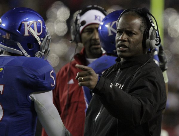 Kansas coach Turner Gill talks to his players after Missouri's failed field goal attempt in the second half Saturday, Nov. 26, 2011 at Arrowhead Stadium.