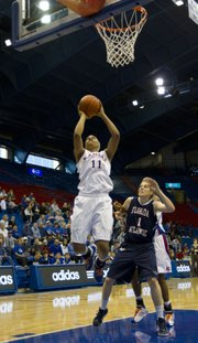 Kansas forward Aishah Sutherland grabs an offensive rebound and puts it back in for two points during KU's final game of the Basketball Travelers Classic against Florida Atlantic on Sunday, Nov. 27, 2011, at Allen Fieldhouse. KU defeated FAU, 82-63, and improved its record to 6-0.