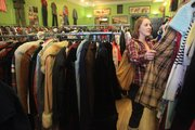 Sorting through racks of clothes, Bayley Hartman, Lawrence, looks for a Christmas present at Wildman Vintage, at 939 Mass.