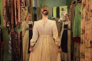 Christina Mecca 28, Lawrence, tries on a dress at Wildman Vintage, which has a wide variety of clothes to suit the dress codes of many. When buying clothes as a gift, keep in mind that vintage sizing often runs smaller, and try to get the washing instructions for the recipient.