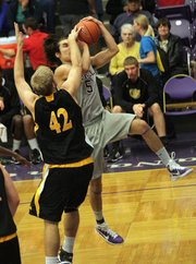 Ottawa University's Colby Regier blocks a shot by Haskell's Brady Fairbanks as the Haskell men hosted Ottawa University on Monday.