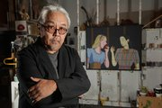 "Retired Kansas University professor Roger Shimomura spent part of his childhood in interment camps after the bombing of Pearl Harbor. Behind him is one of several paintings he&squot;s done from his experiences in the camps, entitled ""Classmates."""
