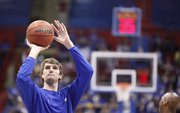 Kansas center Jeff Withey puts up a shot during warmups before tipping off against Florida Atlantic on Wednesday, Nov. 30, 2011 at Allen Fieldhouse.