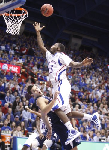 Kansas guard Elijah Johnson is called for a charge as he collides with Florida Atlantic guard Pablo Bertone during the first half Wednesday, Nov. 30, 2011 at Allen Fieldhouse.