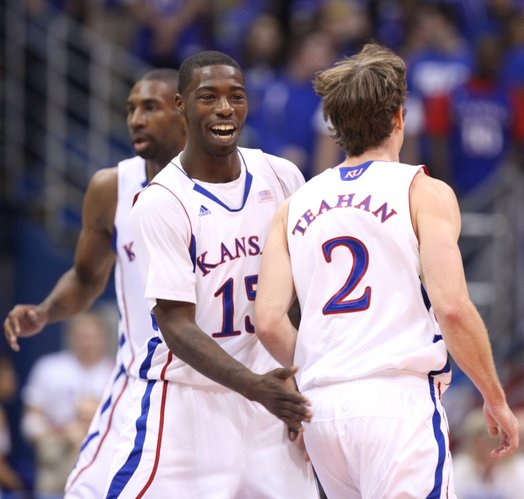 Kansas guard Elijah Johnson gives a slap to teammate Conner Teahan after a three-pointer against Florida Atlantic during the first half Wednesday, Nov. 30, 2011 at Allen Fieldhouse.