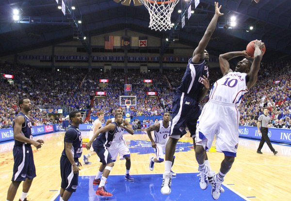 Kansas guard Tyshawn Taylor hangs for a shot before being fouled by Florida Atlantic forward Andre Mattison during the second half on Wednesday, Nov. 30, 2011 at Allen Fieldhouse.
