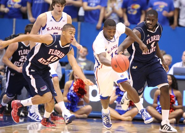 Kansas guard Elijah Johnson splits Florida Atlantic defenders Dennis Mavin (10) and Andre Mattison (4) for a loose ball during the second half on Wednesday, Nov. 30, 2011 at Allen Fieldhouse.