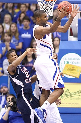 Kansas forward Justin Wesley pulls a rebound from Florida Atlantic forward Jordan McCoy during the second half on Wednesday, Nov. 30, 2011 at Allen Fieldhouse.