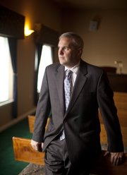 Mike Doering, funeral director at Lawrence Chapel Oaks Funeral Home, 3821 W. Sixth Street, is pictured Thursday, Dec. 1, 2011. Doering took over as funeral director in August and has been in the business for 25 years.