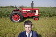 In this 2009 file photo, second-year Future Farmers of America member Stuart Wakeman is pictured with a 1964 Farmall 806 Diesel that he restored. On Thursday, Kansas Governor Sam Brownback and Attorney General Derek Schmidt submitted a letter urging the U.S. Department of Labor to revise its newly proposed rule pertaining to child labor laws on Kansas family farms.