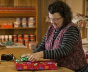 Susie Huffman has been wrapping gifts seasonally for Weaver's Department Store since 1995. She says a comfortable work surface makes gift wrapping go a lot smoother.