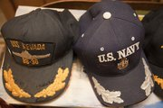 Dorwin Lamkin has a selection of caps he keeps by his door ready to wear. Lamkin is one of a handful of Kansas survivors from the attack on Pearl Harbor. He was on the USS Nevada.