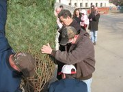 Gov. Sam Brownback on Friday helps put up Christmas Tree outside the Capitol.