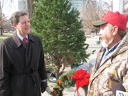 Gov. Sam Brownback (left) speaks on Friday with Harry Peckham, who donated the Christmas Tree from his Memory Lane Christmas Tree Farm.