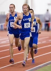 Kansas running Eric Dyson, center, keeps pace during the men&#39;s 3000-meter race during the Bob Timmons Challenge on Friday, Dec. 2, 2011 at Anschutz Pavilion. KU&#39;s Don Wasinger, left, won the event.