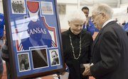 Former Kansas track coach Bob Timmons, right, with his wife, Pat, is recognized Friday, Dec. 2, 2011 during the Bob Timmons Challenge at Anschutz Sports Pavilion. Timmons will be inducted into the USA Track and Field Hall of Fame in St. Louis on Saturday.
