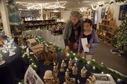 Meredith Lang and her daughter Amelia, 8, stopped by the Centenary United Methodist Church, 245 N. Fourth St., Saturday to view the Festival of the Nativities. The display will continue noon to 4 p.m. weekends until Dec. 18 and from 6:30 p.m. to 8:30 p.m. Dec. 15.